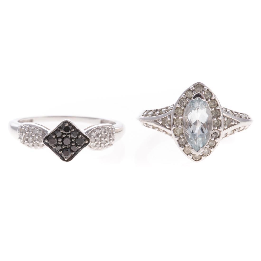 An Aquamarine Ring & Black & White Diamond Ring