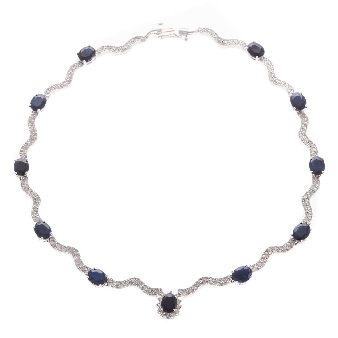 A Lady's Sapphire and Diamond Necklace in 14K