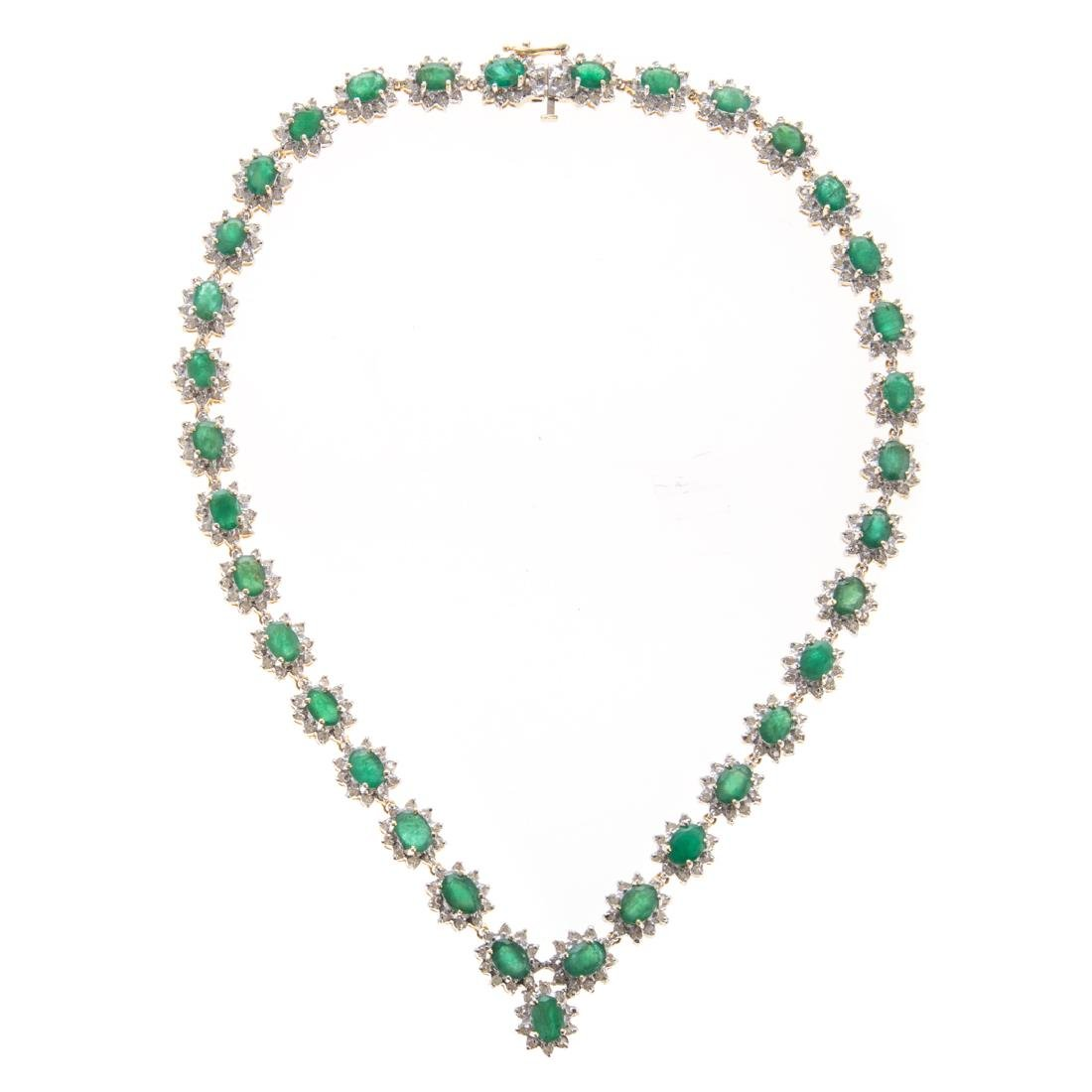 A Lady's Emerald & Diamond Necklace in 14K