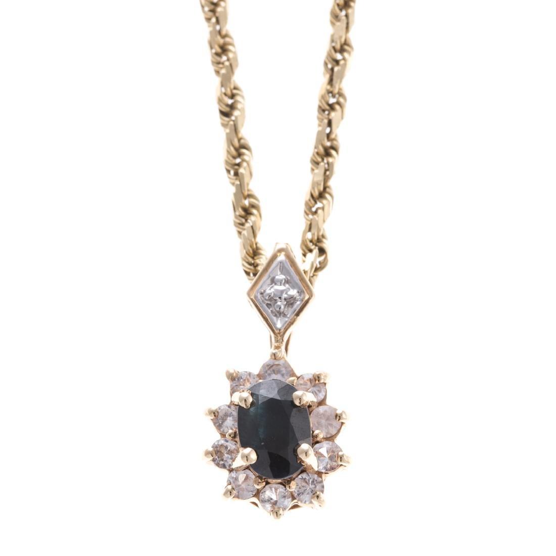 A Lady's Sapphire & Diamond Pendant in Gold