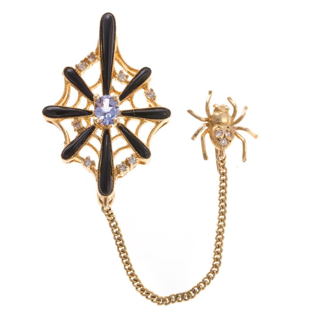 A Spider Web Pin with Diamonds & Tanzanite in 18K