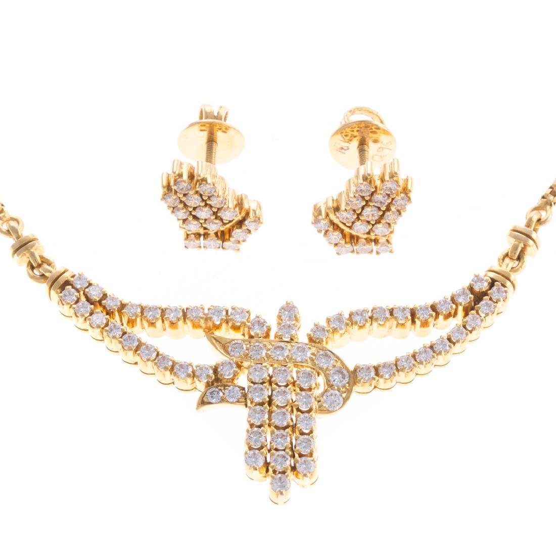 An 18K Diamond Necklace & Matching Earrings