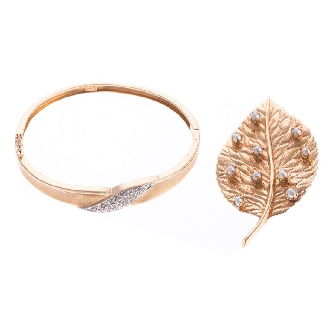 A Pearl Leaf Brooch % Diamond Bracelet in Gold