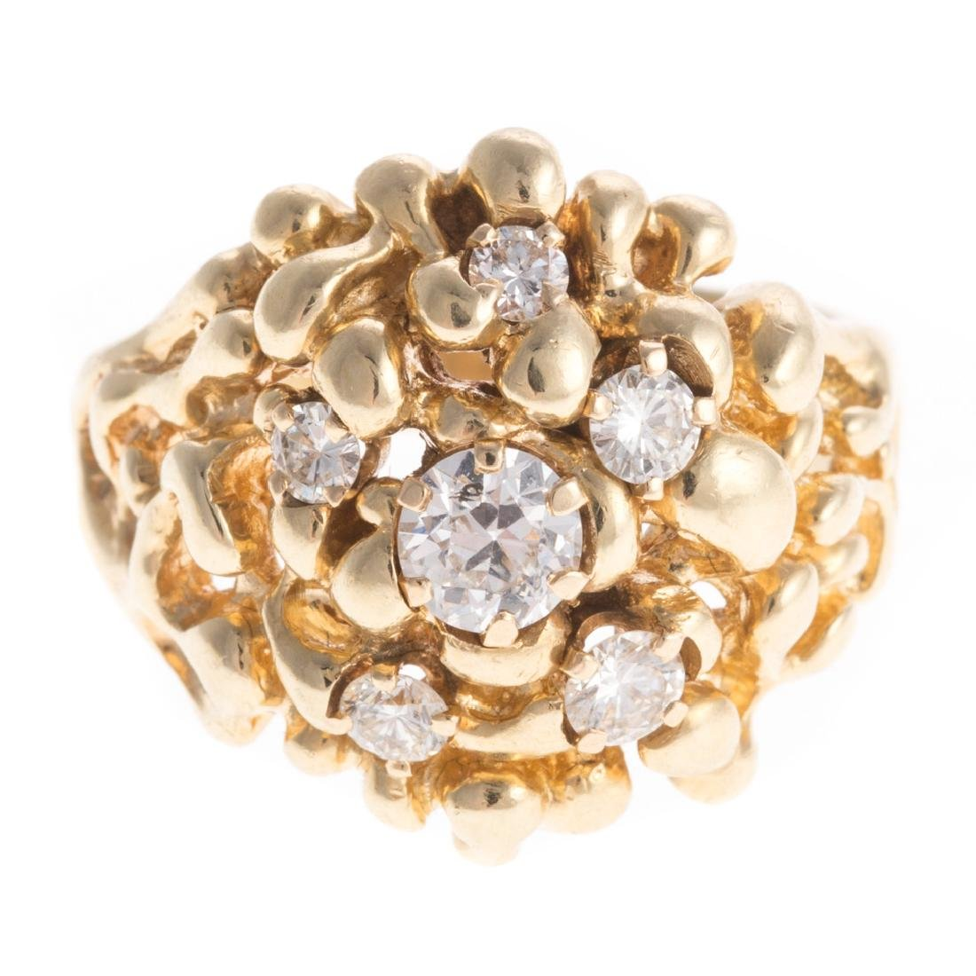 A Lady's Diamond Dome Ring in Gold