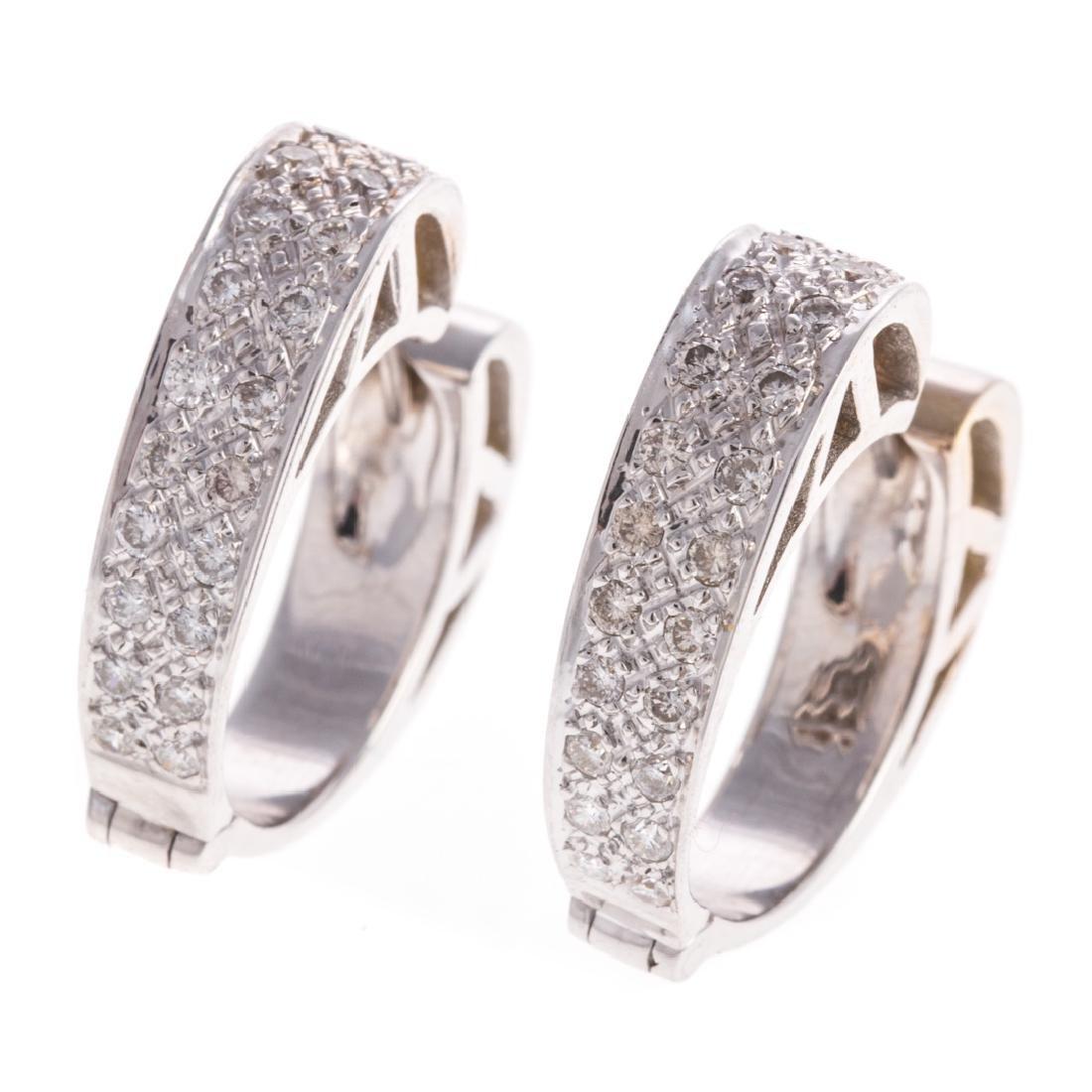 A Pair of Pave Diamond Hoop Earrings in 14K