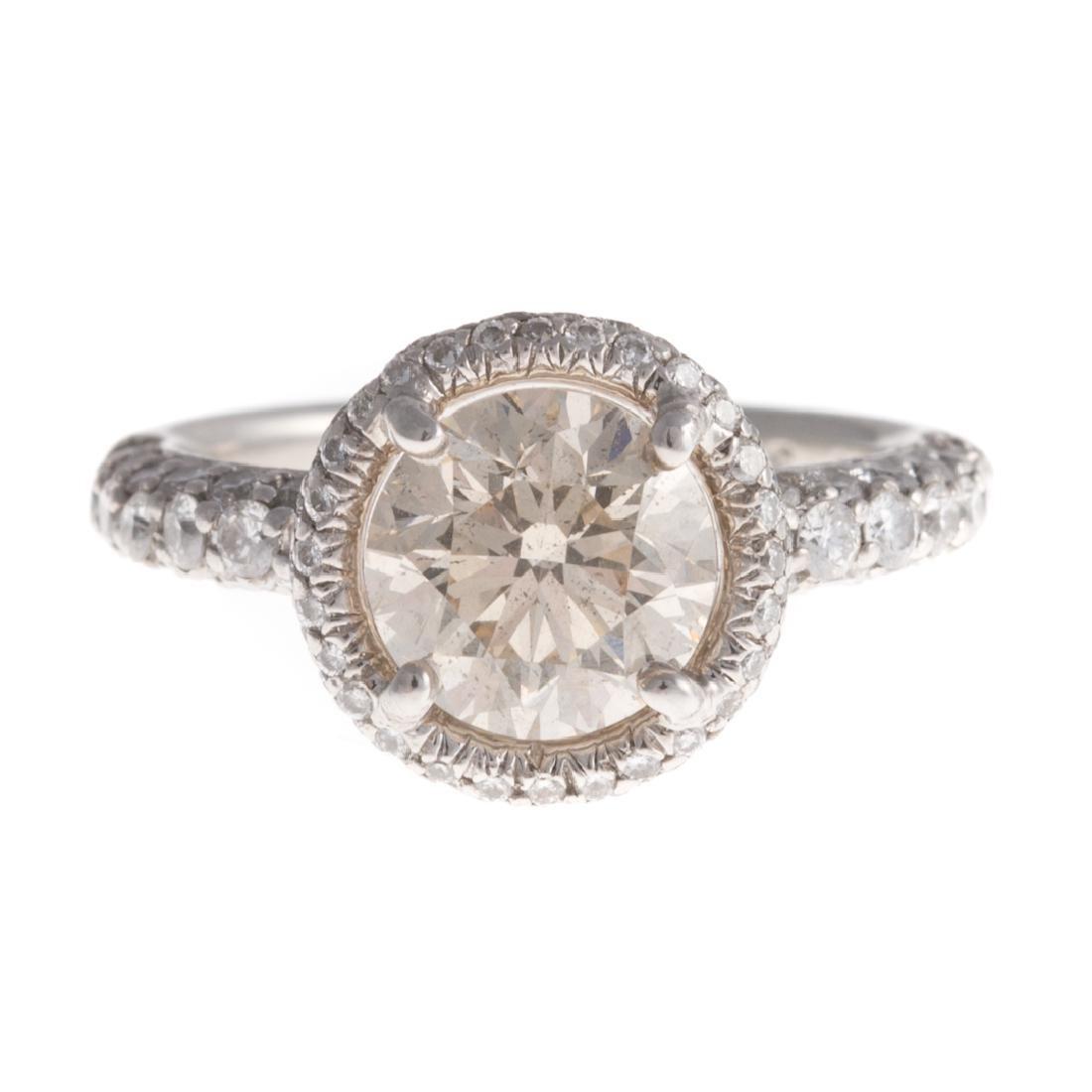 A Lady's Platinum Colored Diamond Ring