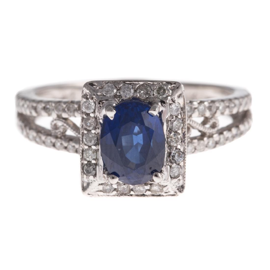 A Lady's 14K White Gold Sapphire & Diamond Ring