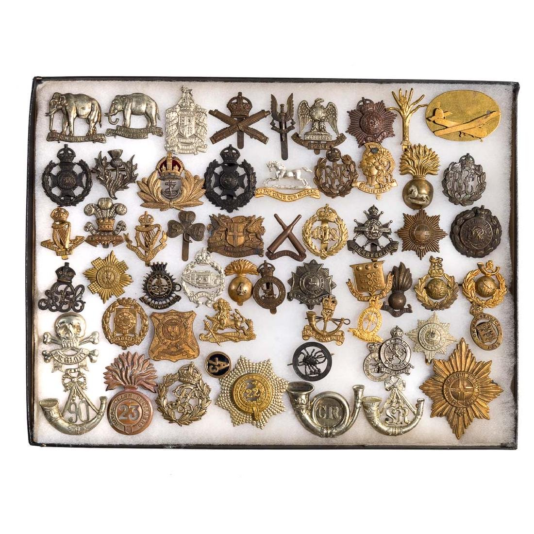 Group of British military headwear badges