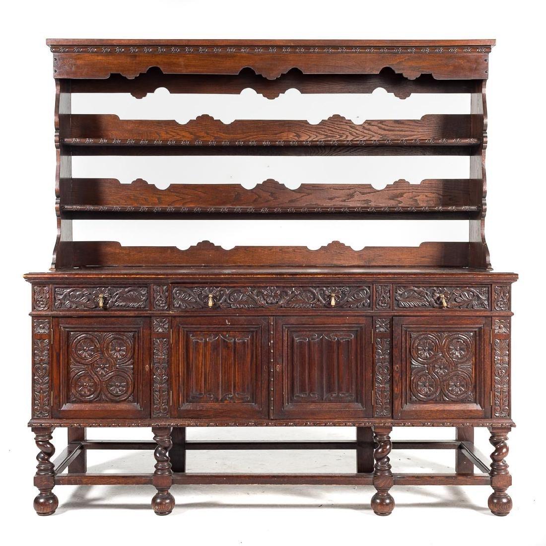 Jacobean Revival style carved oak dresser,