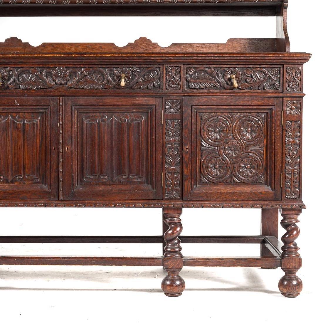 Jacobean Revival style carved oak dresser, - 2