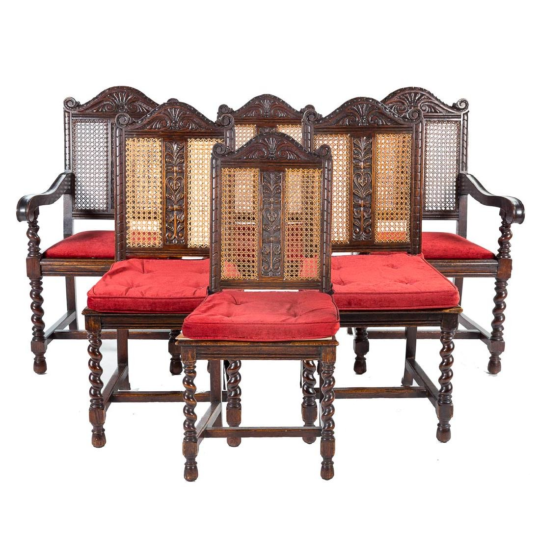 Six Jacobean Revival carved oak dining chairs