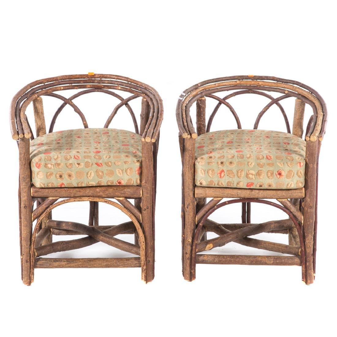 Pair Adirondack style bent twig arm chairs,