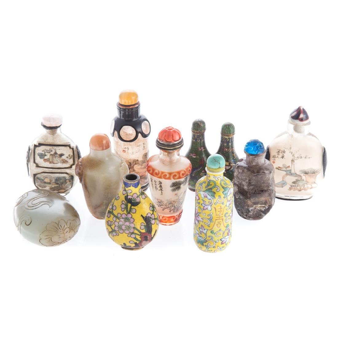 10 Assorted Chinese snuff bottles in fitted case