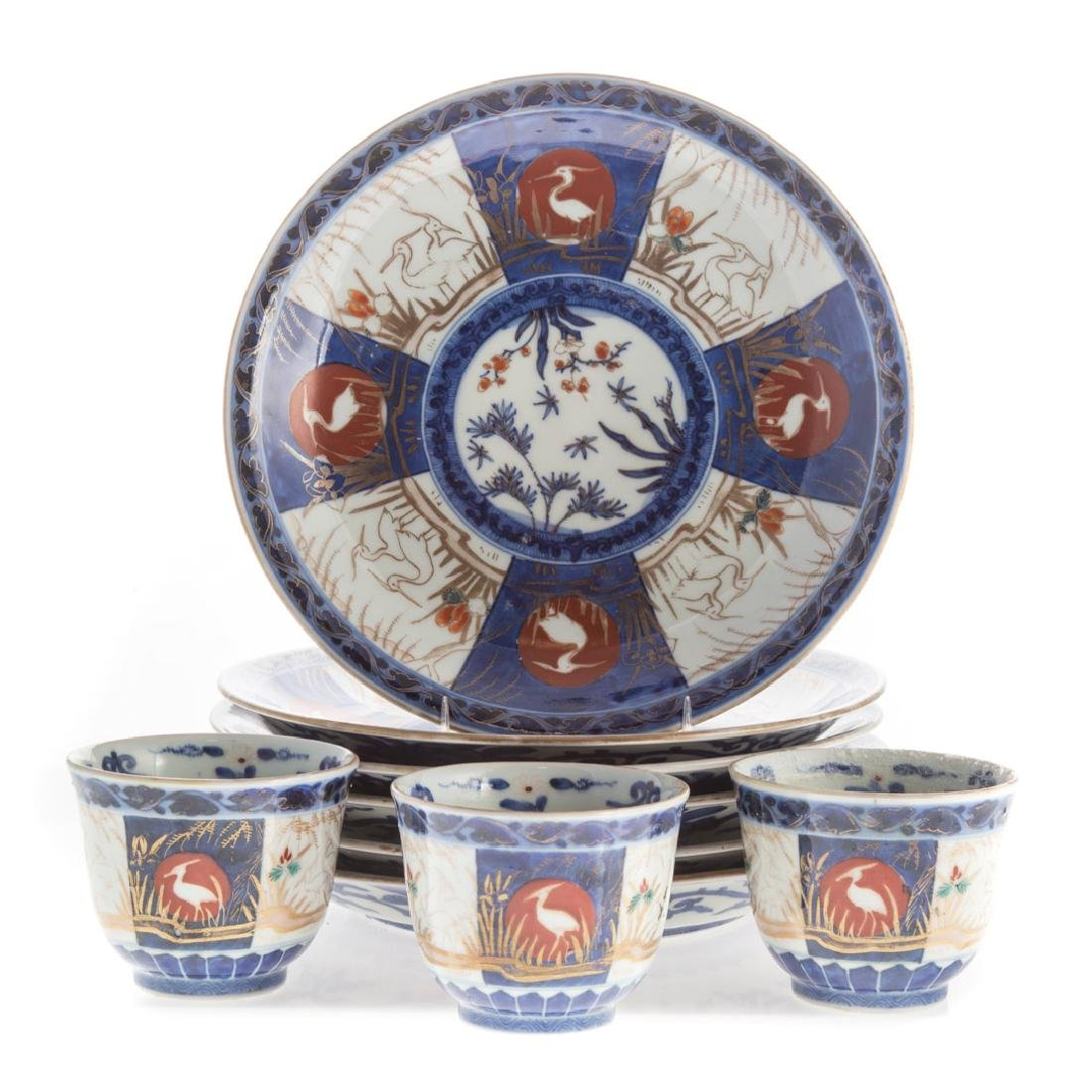 Nine Japanese Imari porcelain plates and cups