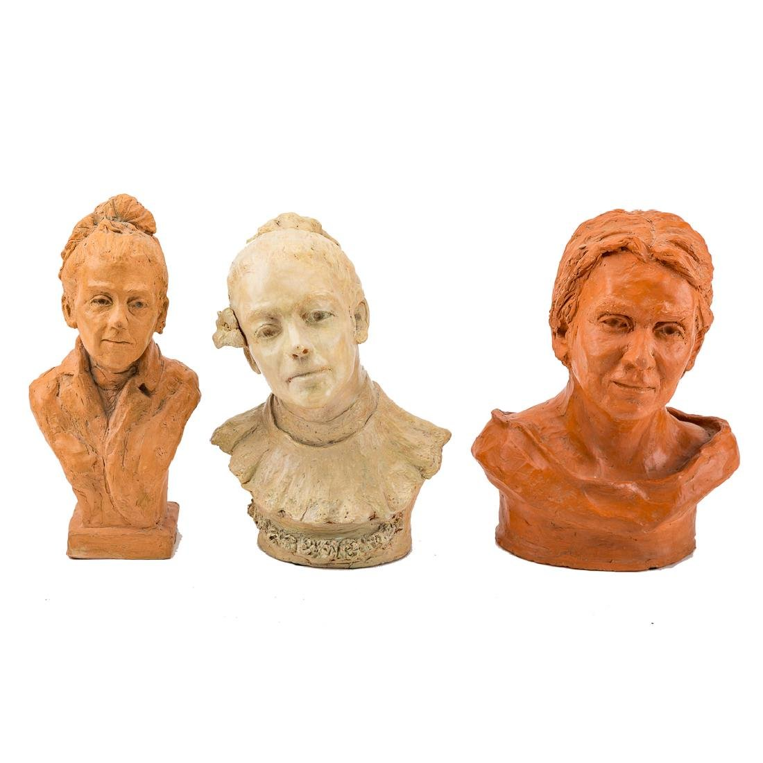 Three Schuler school terracotta busts
