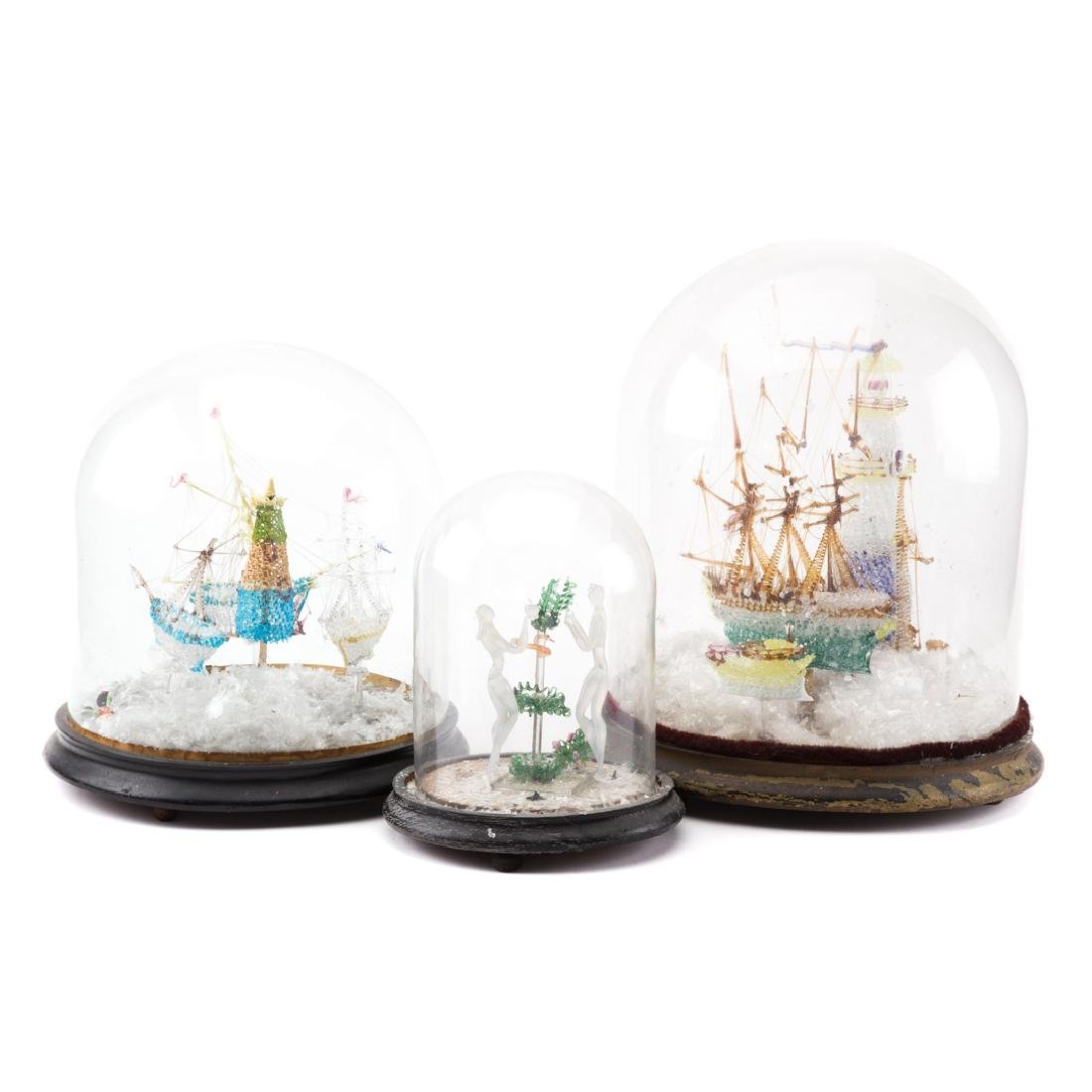 Three blown glass dioramas with domes
