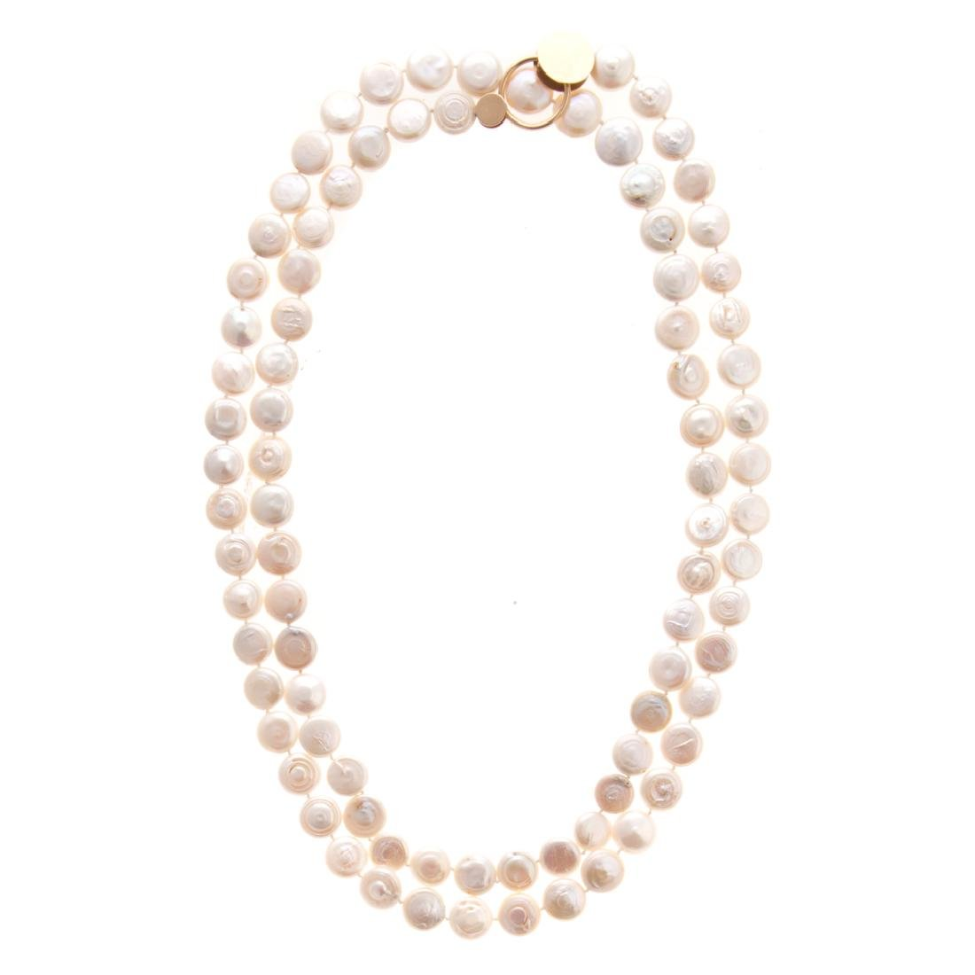 A Lady's Coin Pearl Necklace by Betty Cooke