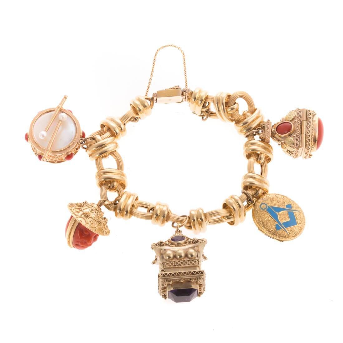 A Wide 14K Charm Bracelet with 5 Gemstone Charms