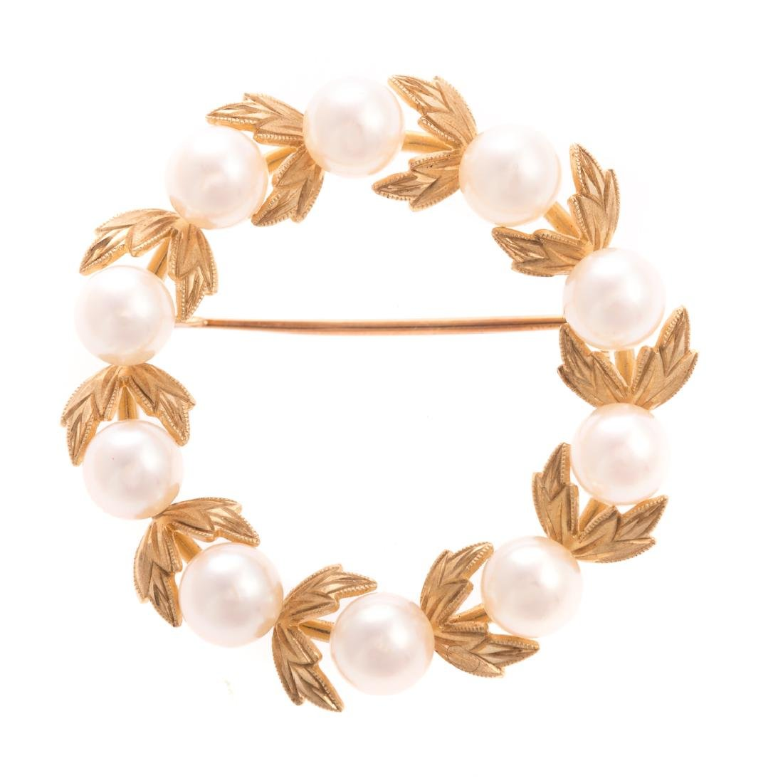 A Lady's 14K Open Circle Leaf Pearl Brooch