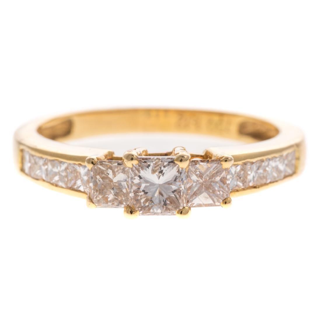 A Lady's Princess Cut Diamond Ring in 18K Gold