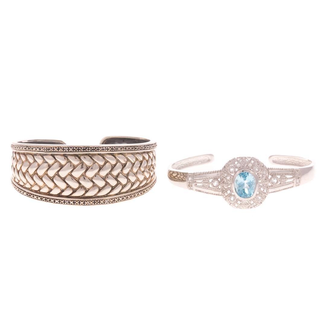 A Pair of Wide Silver Cuff Bracelet