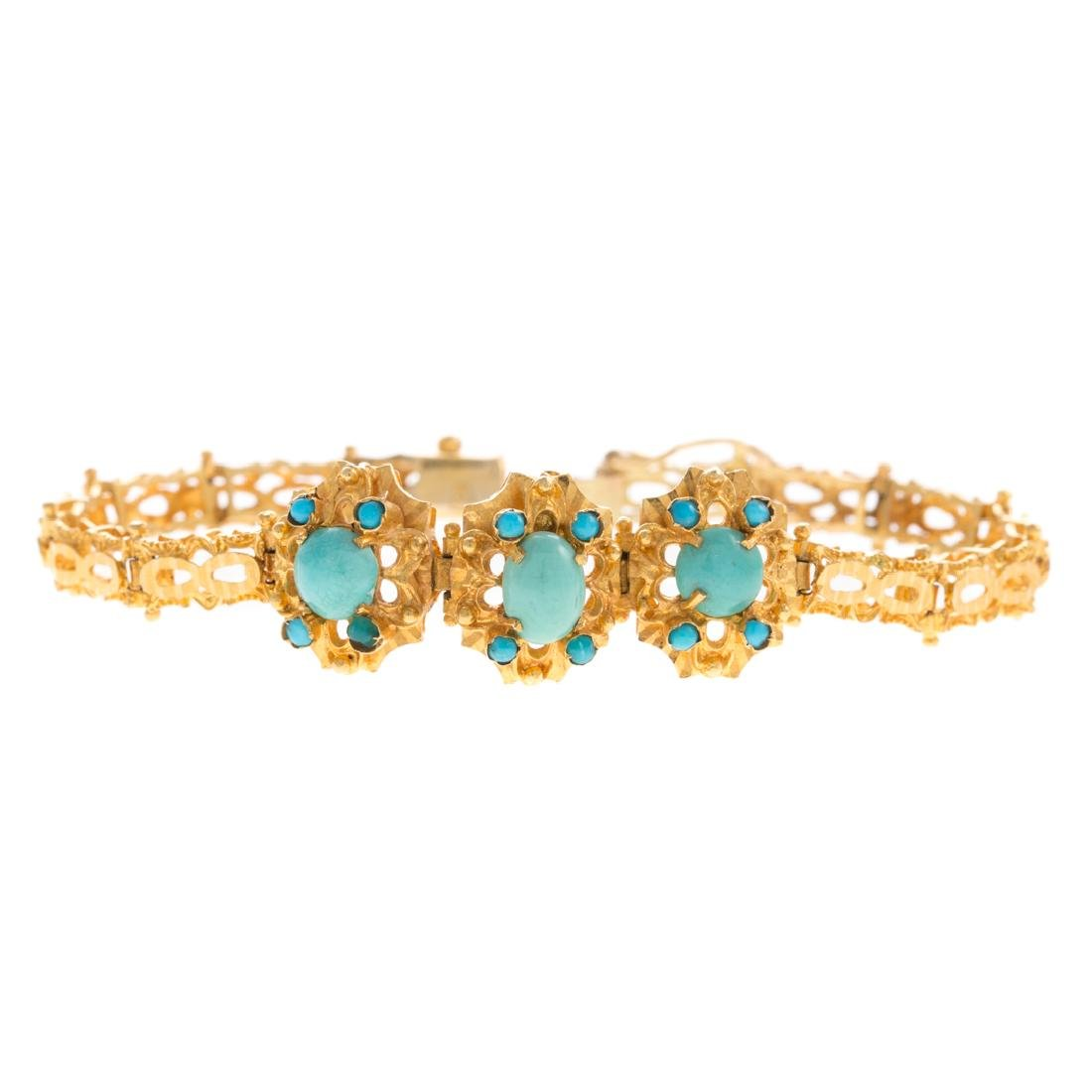 A Lady's 18K Yellow Gold Turquoise Link Bracelet