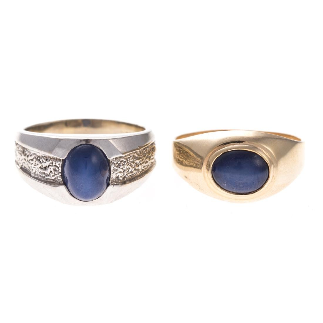 A Pair of Gent's Star Sapphire Rings in Gold