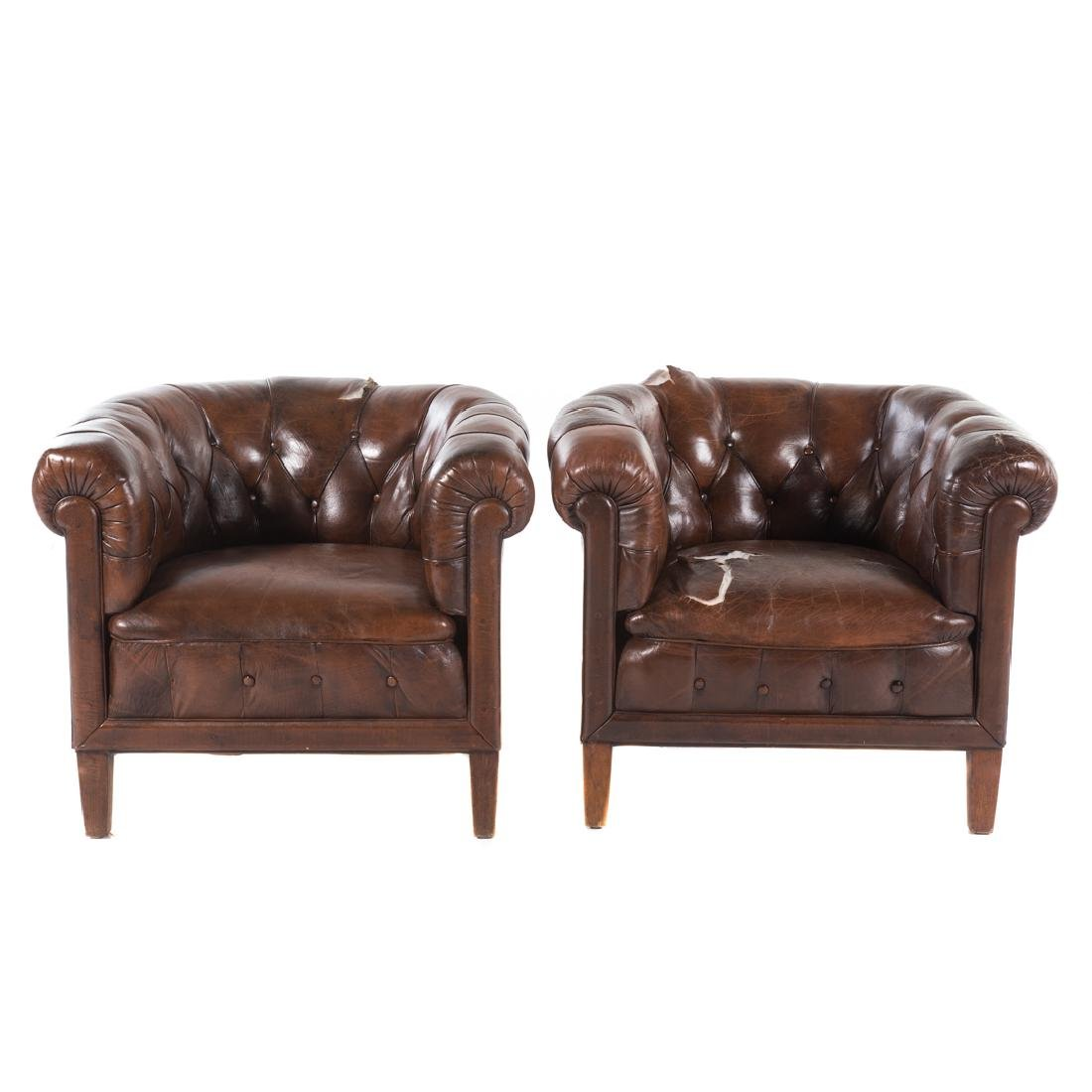 Pair French tufted leather upholstered tub chairs