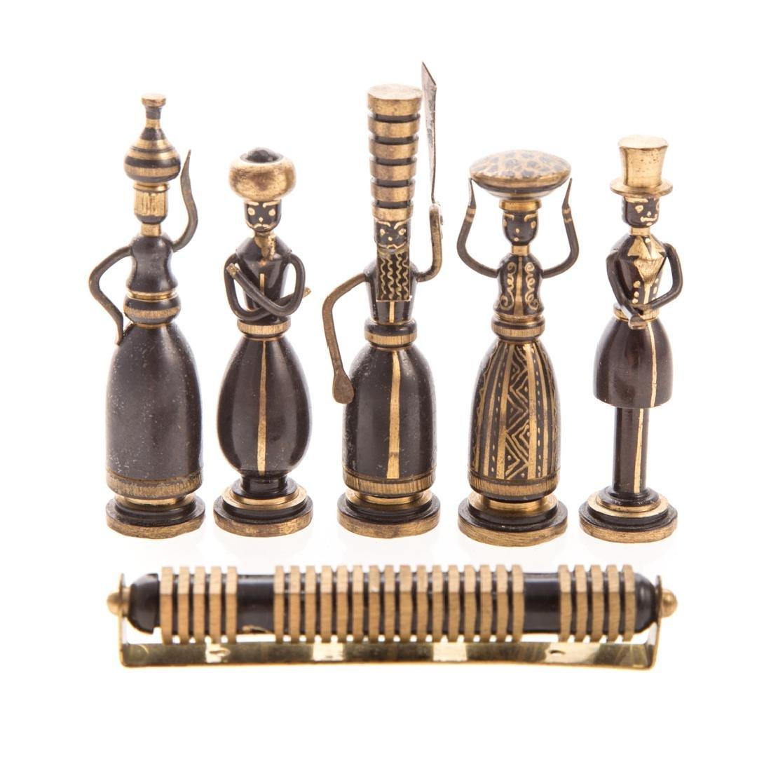 Hans Teppich. Five brass figures and a Mezuzah