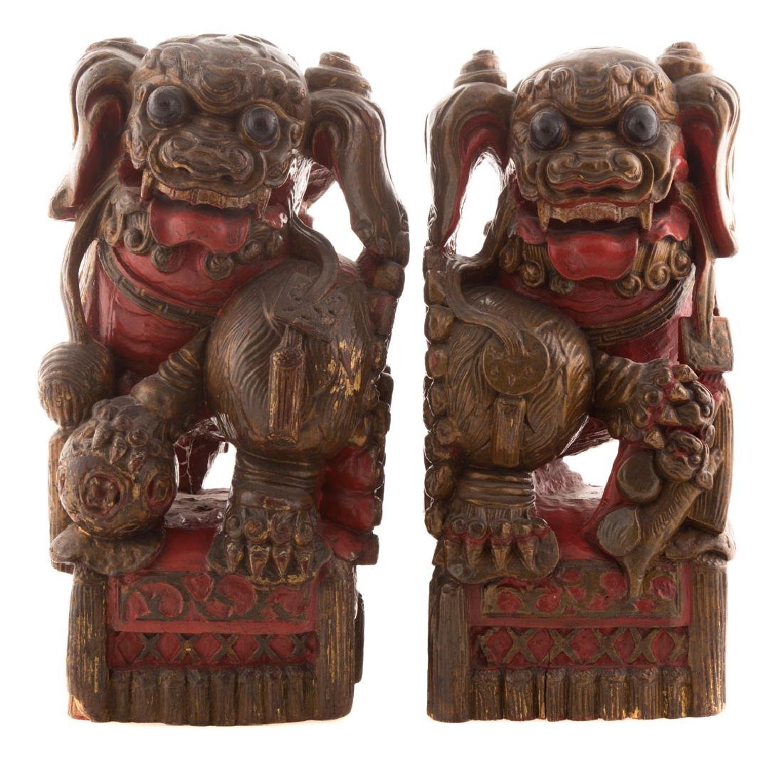 Pair Chinese carved and polychromed wood foo dogs