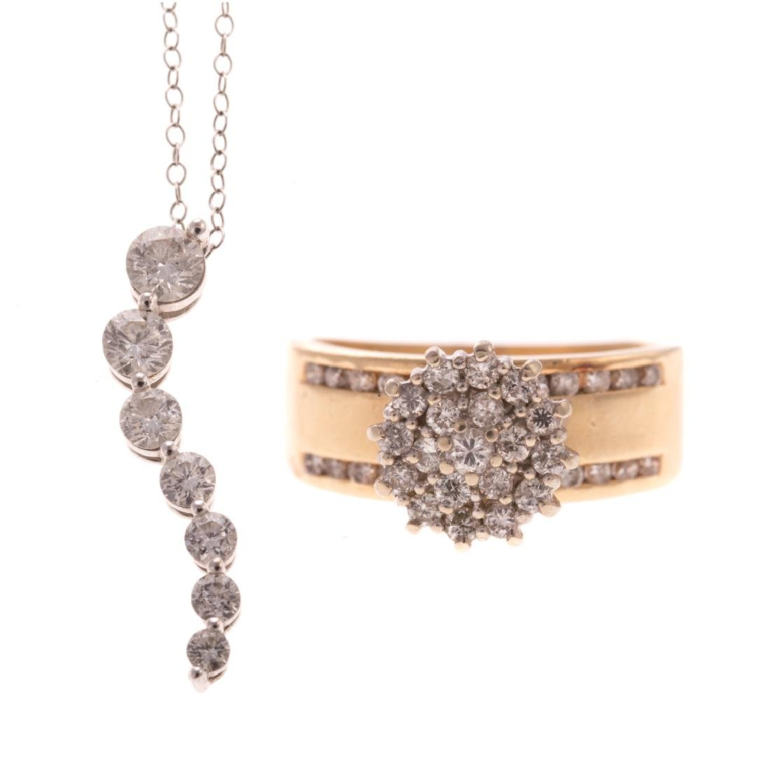 A Lady's Diamond Pendant and Cluster Ring in Gold