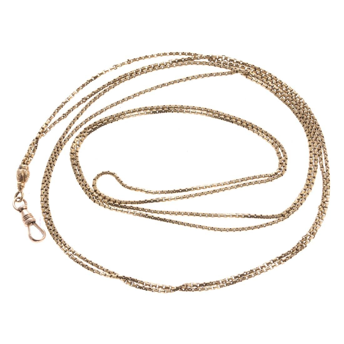 A Long Chain Link Necklace in 14K Yellow Gold