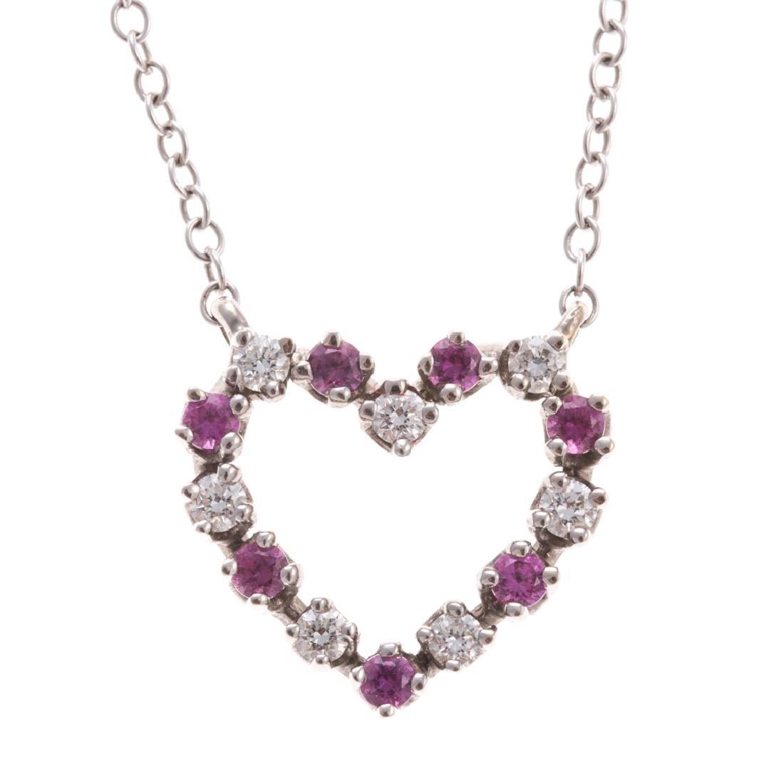 A Lady's Ruby & Diamond Heart Necklace in 18K