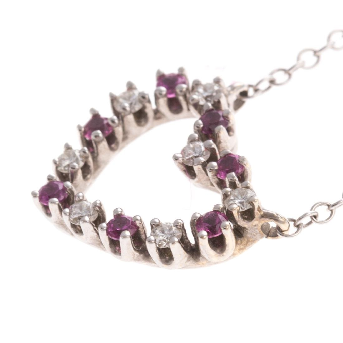 A Lady's Ruby & Diamond Heart Necklace in 18K - 2