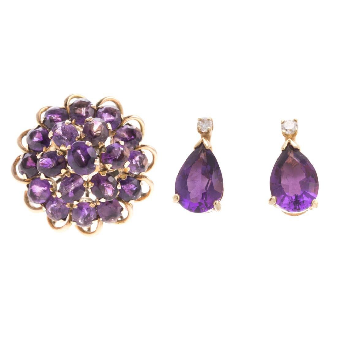 A Lady's Amethyst Ring & Earrings