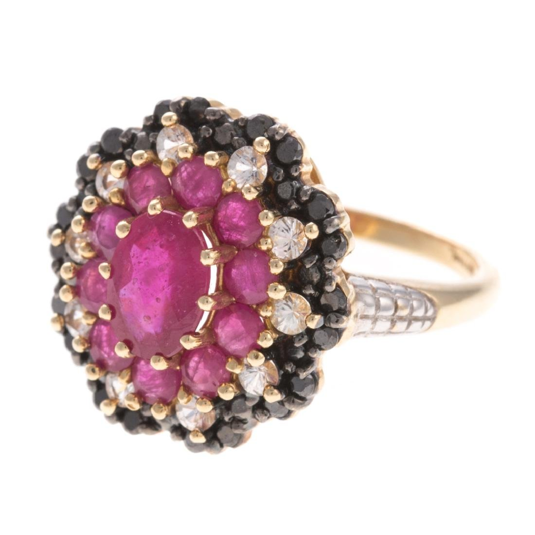 A Lady's Diamond & Ruby Ring in 10K - 4