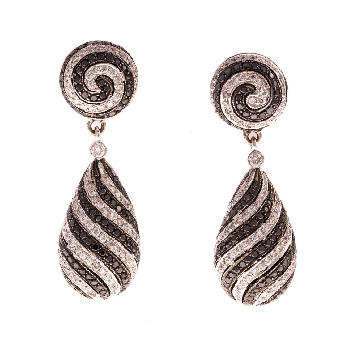 A Pair of Spiral Black & White Diamond Earrings