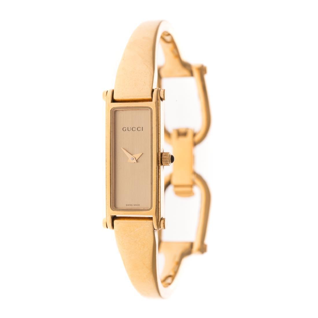 A Lady's Gucci Gold Bracelet Watch