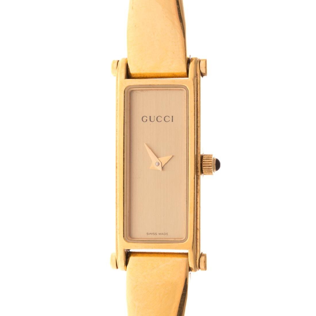 A Lady's Gucci Gold Bracelet Watch - 2