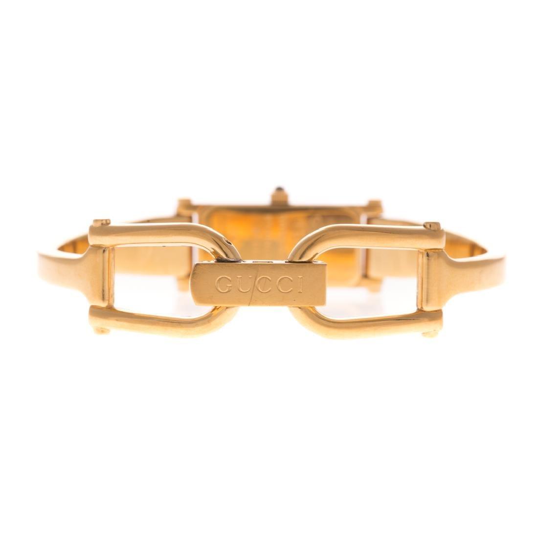 A Lady's Gucci Gold Bracelet Watch - 3
