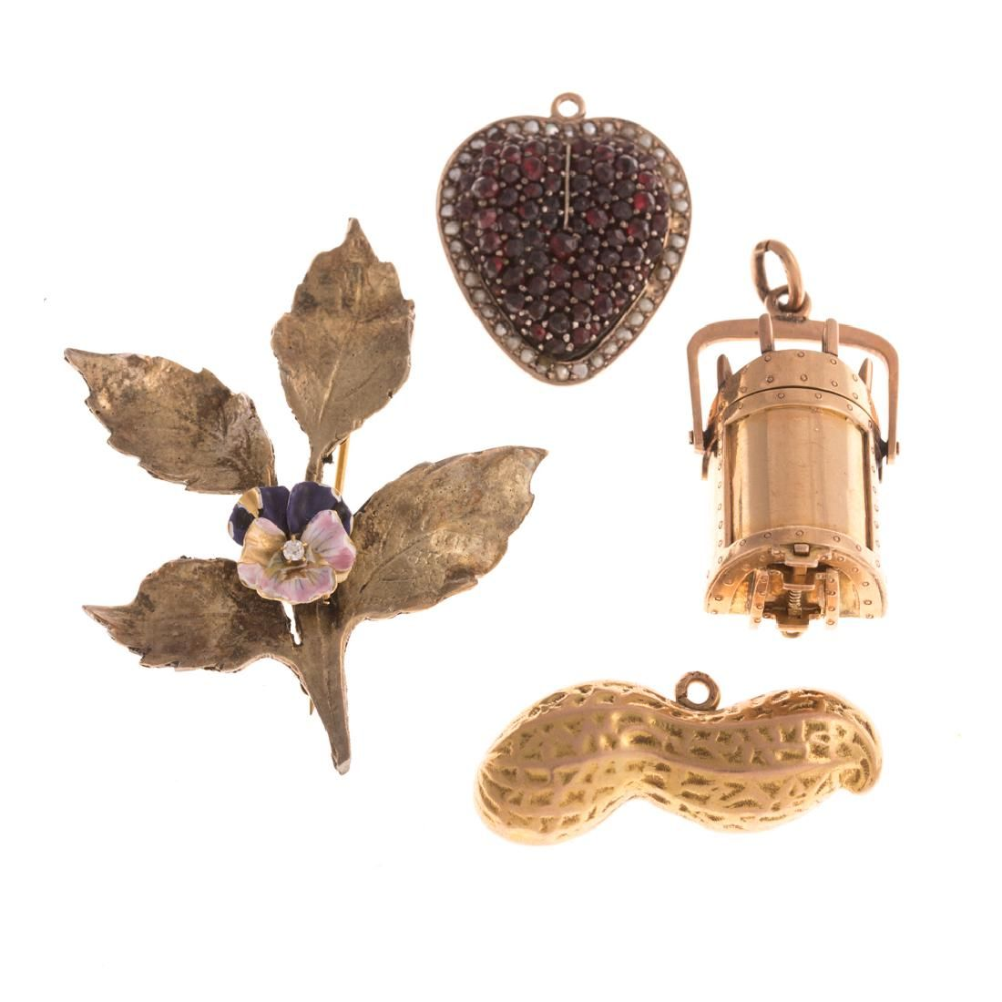 A Collection of Victorian Jewelry Featuring Charms