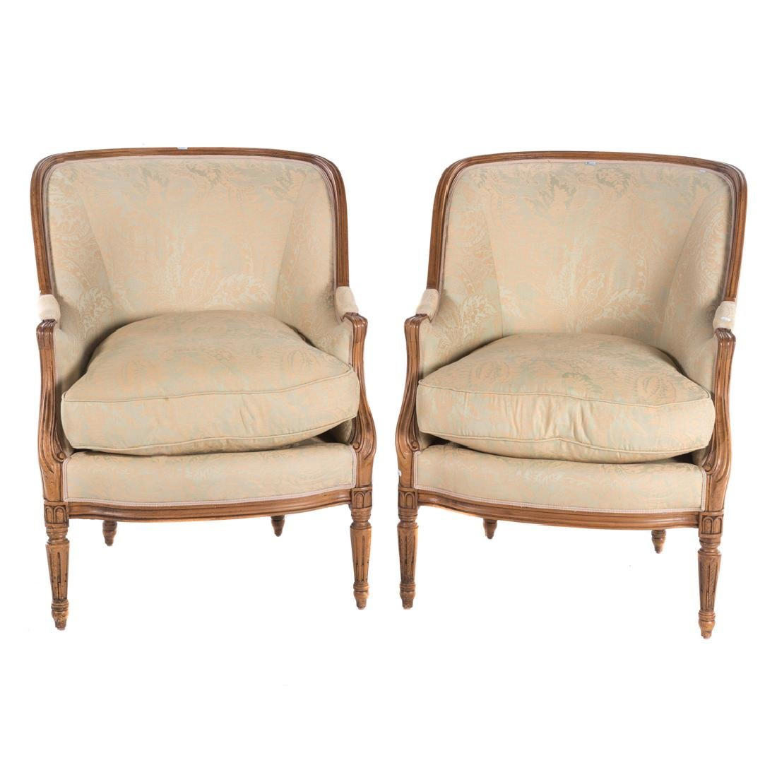 Pair Louis XVI style carved fruitwood bergeres