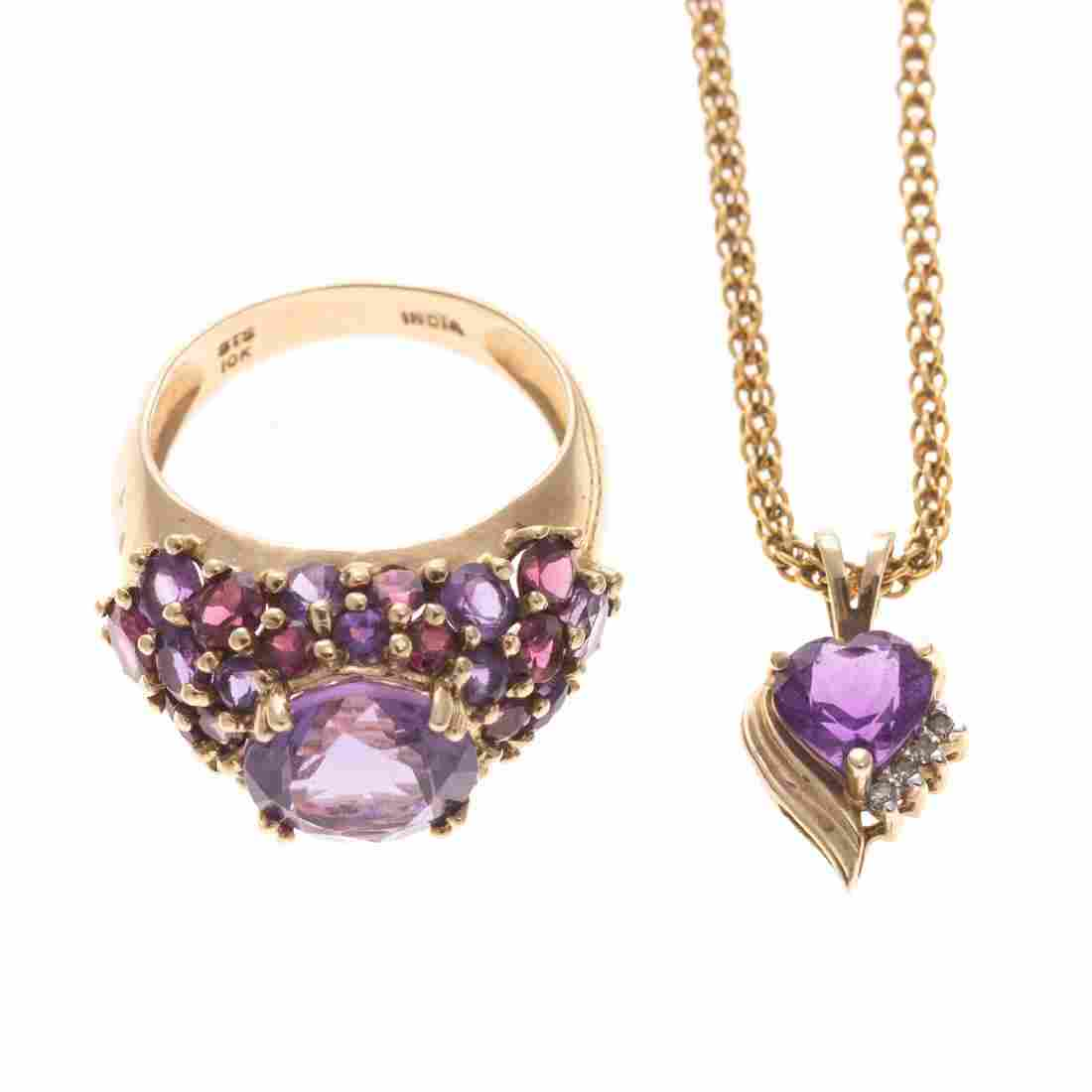 A Lady's Amethyst Ring and Pendant in Gold