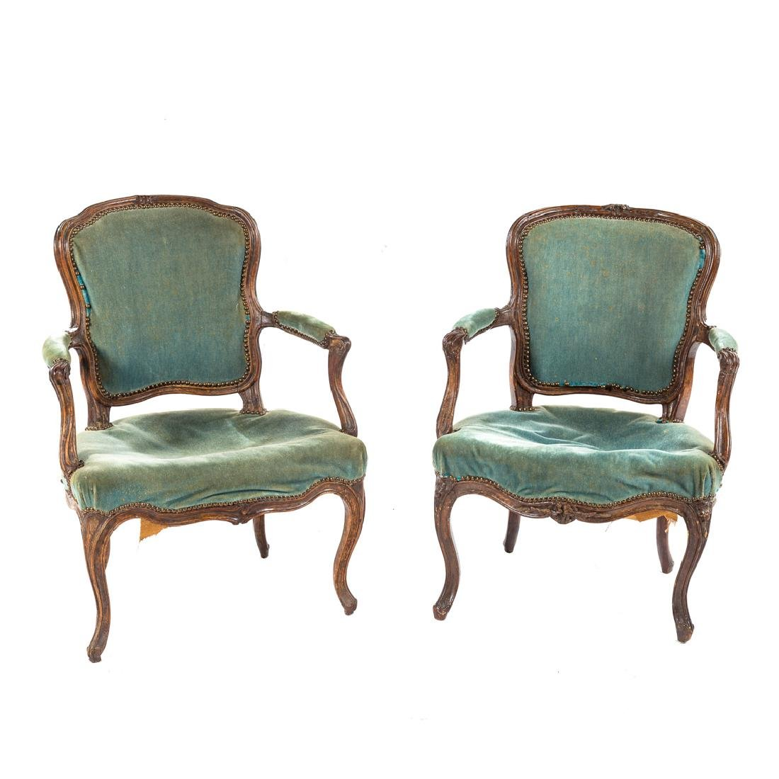 Two Louis XV carved walnut fauteuils