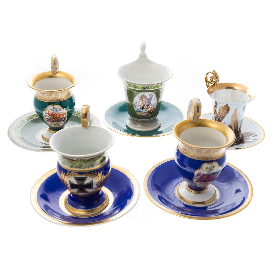 Four KPM porcelain cups and saucers
