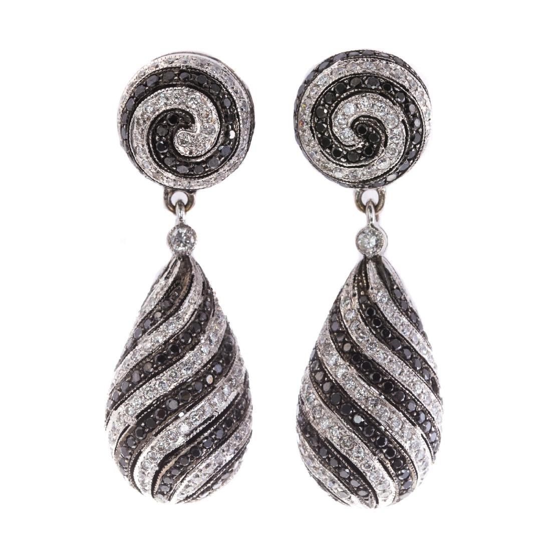 A Pair of Spiral Black & White Diamond Earrings