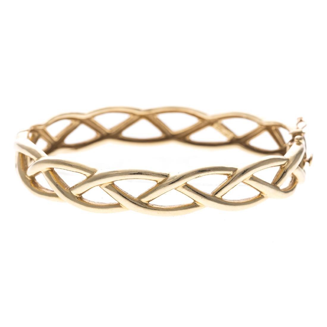 A Lady's 14K Open Weave Bangle Bracelet