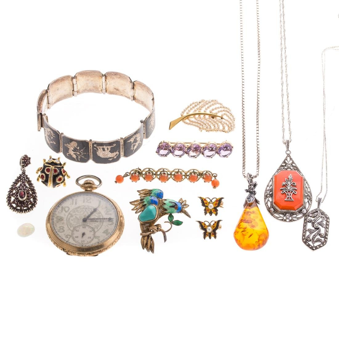 A Collection of Lady's Jewelry Featuring Amber