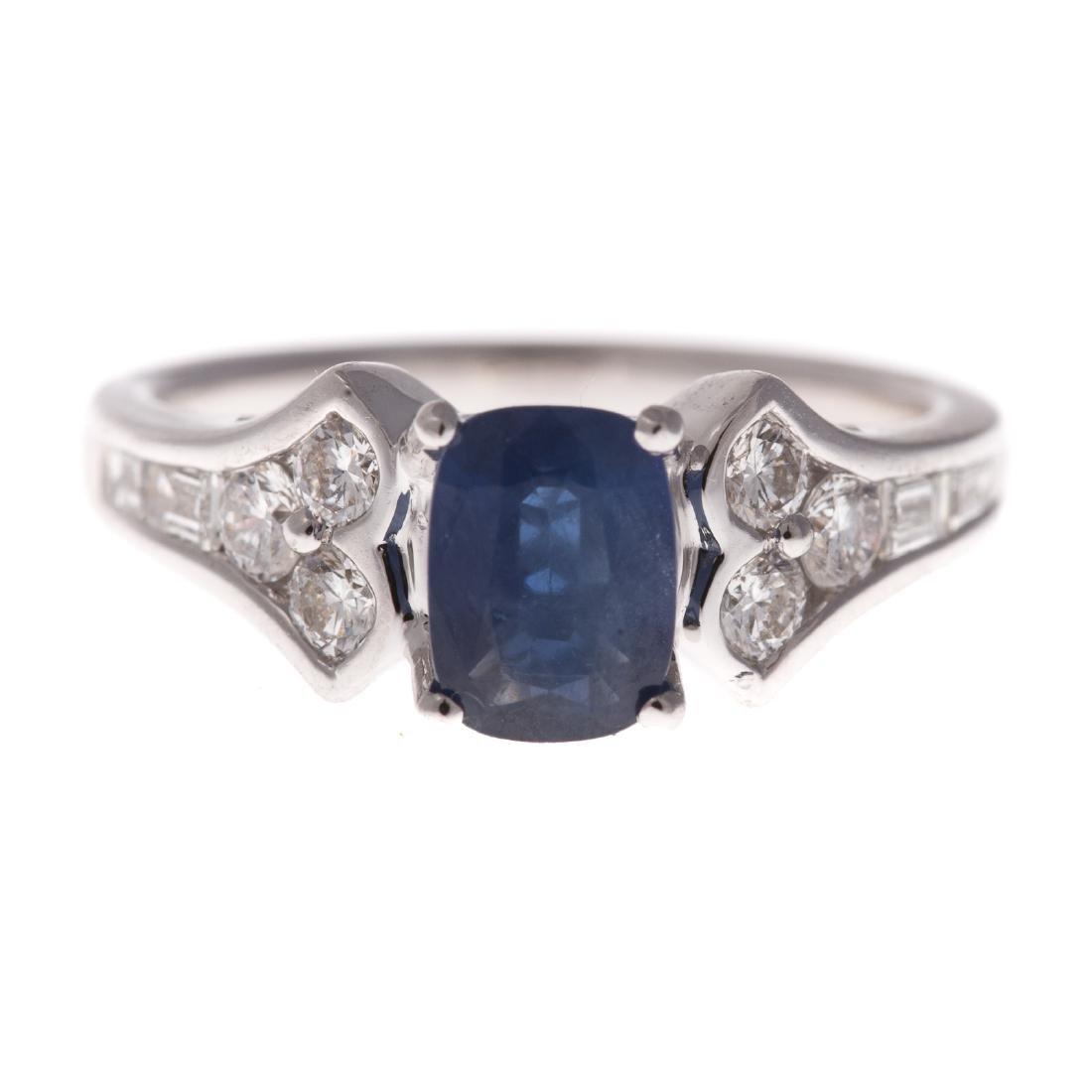 A Lady's 18K Sapphire & Diamond Ring