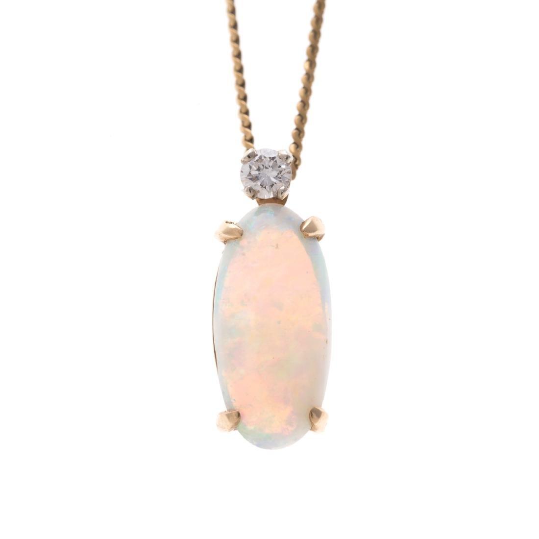 A Lady's 18K Opal and Diamond Pendant